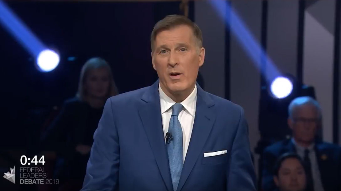 Maxime Bernier answers a question about Canada on the world stage